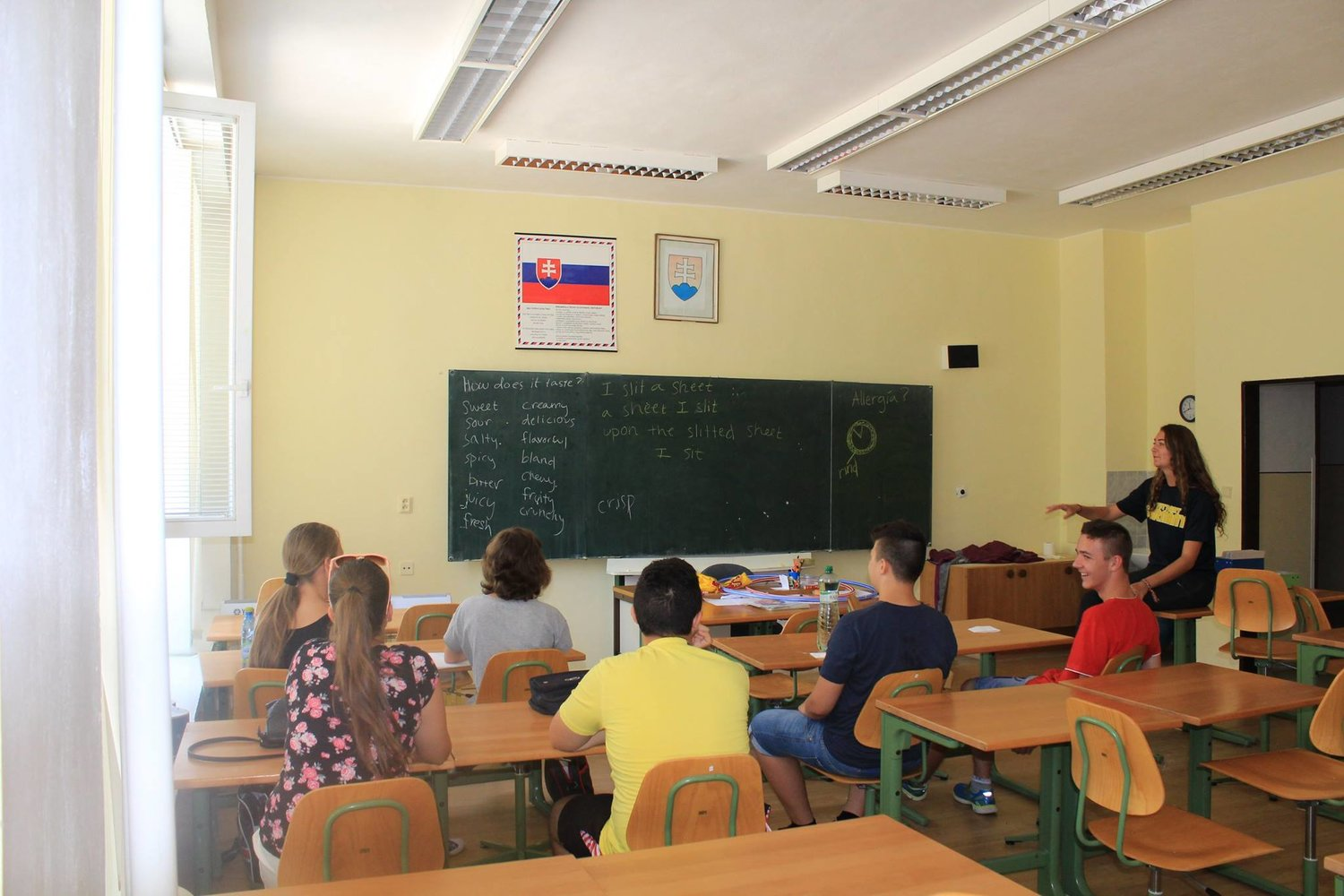 Volunteer teaching in a nice classroom