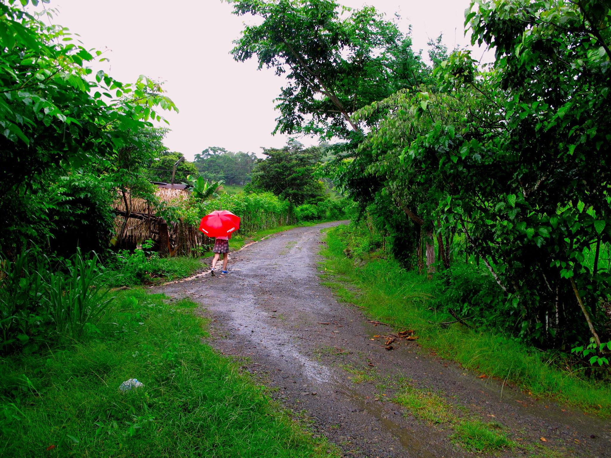 Girl Walking down dirt road in Panama