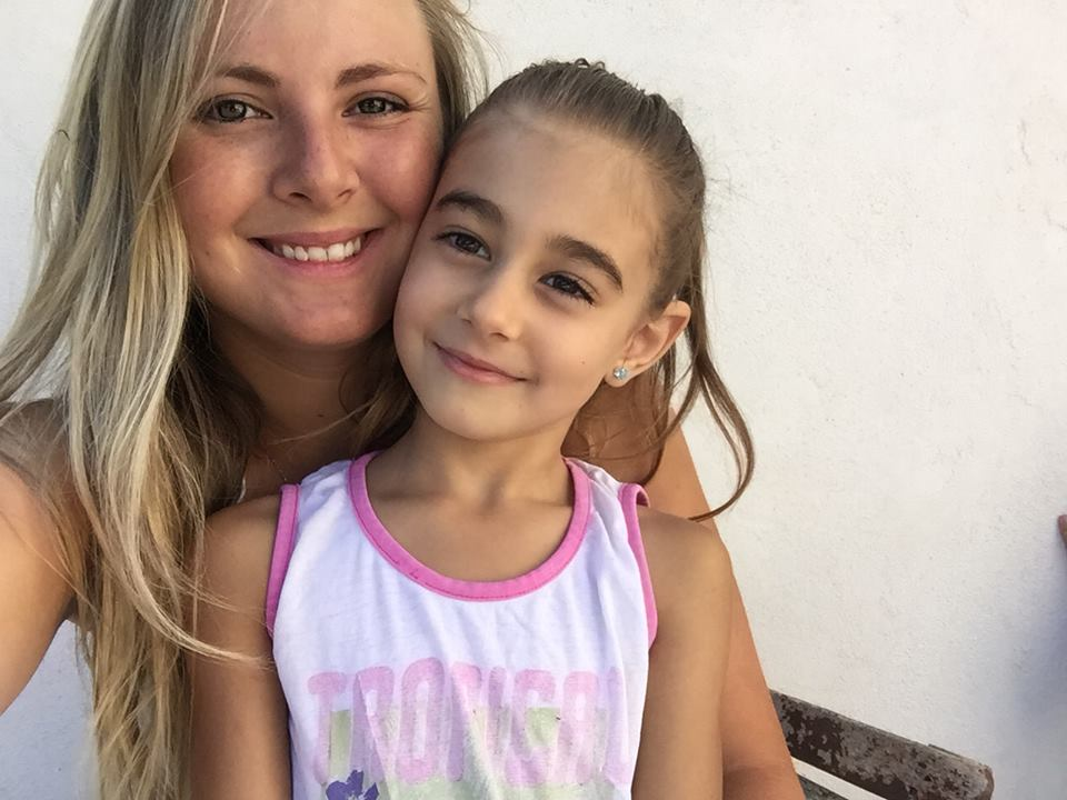 Picture of Carina and little girl smiling into the camera